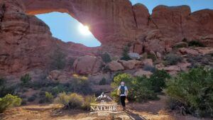 hiking to the south window arch at arches national park 01