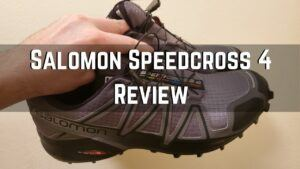 me holding my salomon speedcross 4 sneakers
